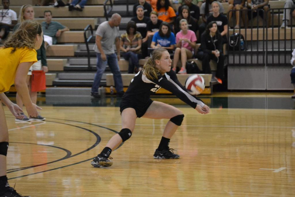 Junior Kaitlin Norman dug the ball in a match on Saturday.