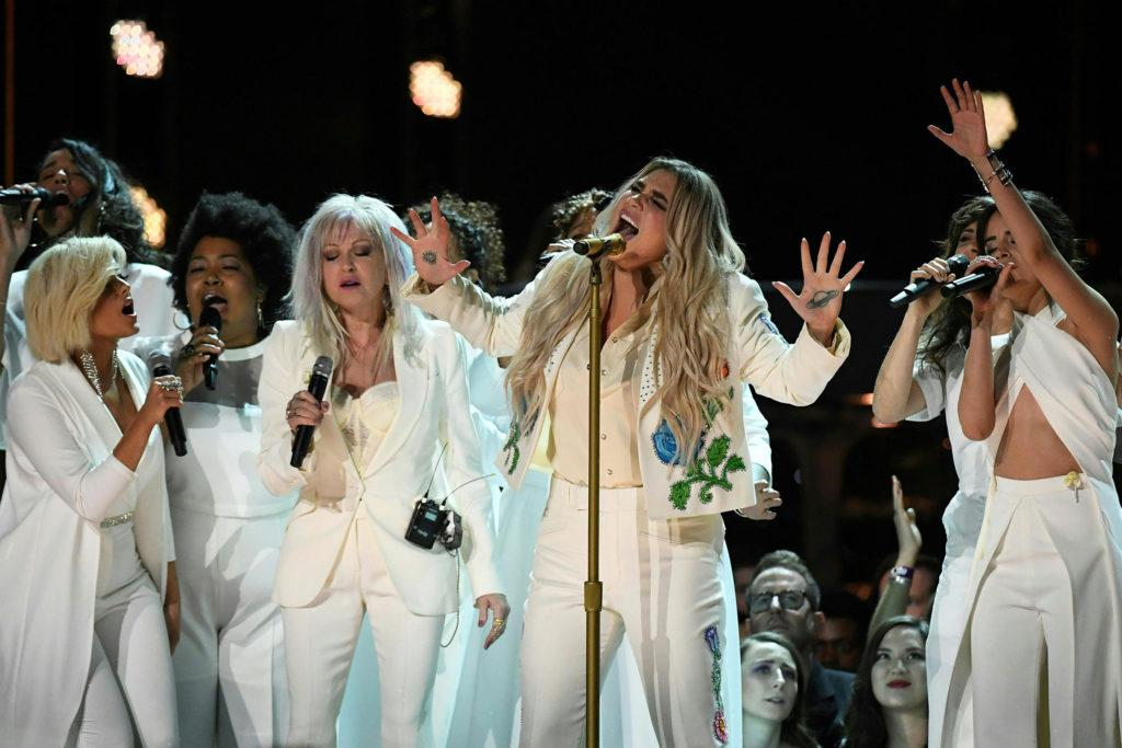 Kesha (C) performs with Bebe Rexha (L), Cindy Lauper (3rd L) and Camila Cabello (R) during the 60th Annual Grammy Awards show on January 28, 2018, in New York.  / AFP PHOTO / Timothy A. CLARY        (Photo credit should read TIMOTHY A. CLARY/AFP/Getty Images)