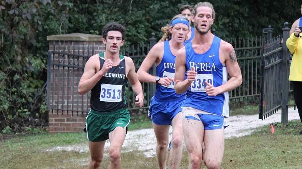 Freshman Conner Moranos (left) competes against runners from Covenant and Berea in the USA South Championships. PHOTO / DANIELLE PERCIVAL