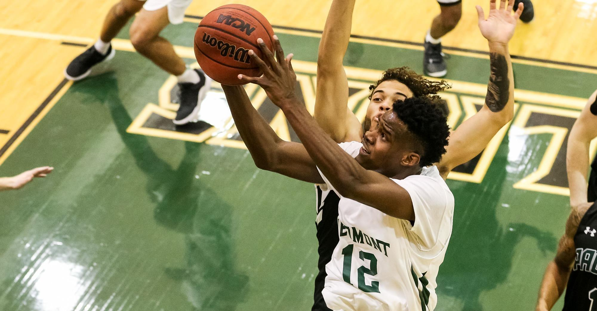 Lanier drives into the paint for a tough layup against William Peace. PHOTO / KARL L. MOORE