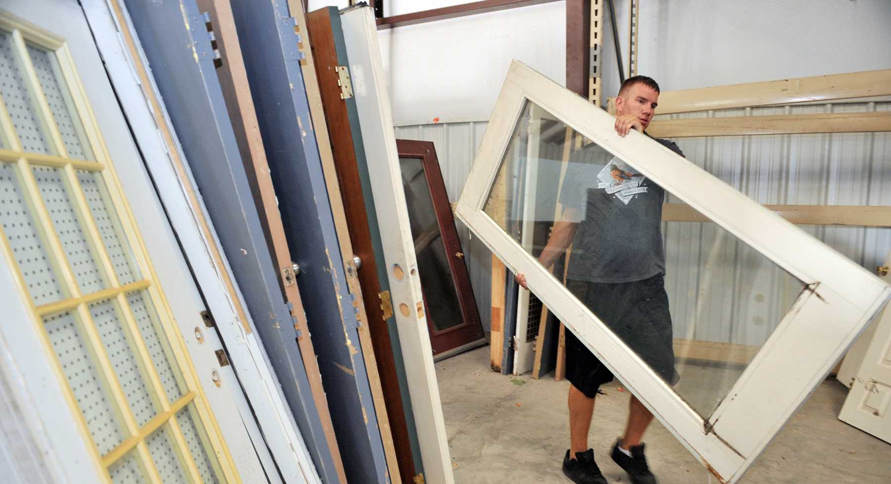 SHAW AIR FORCE BASE, S.C. -- Senior Airman Jason Albrecht, 20th Security Forces military working dog handler, organizes donated doors at the Sumter Habitat for Humanity ReStore, July 27. Proceeds from ReStore sales go into the Sumter Habitat for Humanity building fund. Habitat for Humanity is a non-profit organization that utilizes volunteer labor and donations of money and materials to eliminate poverty housing and homelessness. (U.S. Air Force photo/Senior Airman Kathrine McDowell)