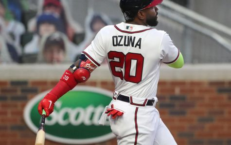 Atlanta Braves designated hitter Marcell Ozuna follows through on a solo home run against the Miami Marlins during the first inning on Tuesday, Sept. 22, 2020, at Truist Park in Atlanta. (Curtis Compton/Atlanta Journal-Constitution/TNS)