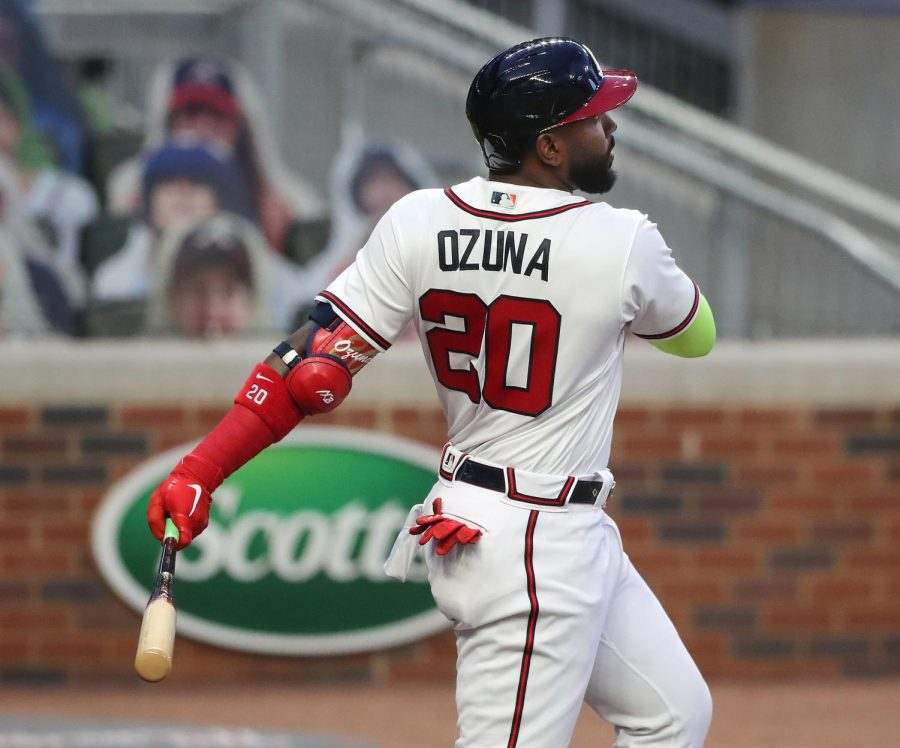 Atlanta+Braves+designated+hitter+Marcell+Ozuna+follows+through+on+a+solo+home+run+against+the+Miami+Marlins+during+the+first+inning+on+Tuesday%2C+Sept.+22%2C+2020%2C+at+Truist+Park+in+Atlanta.+%28Curtis+Compton%2FAtlanta+Journal-Constitution%2FTNS%29