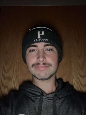 Sophomore Men's Lacrosse Zach Schramm is an encouragement to the rest of his team to participate in the Mustache Madness. Schramm has been personally affected by the HEADstrong foundation and wants his teammates to help positively affect others who are in need.  Picture: Courtesy of Zach Schramm