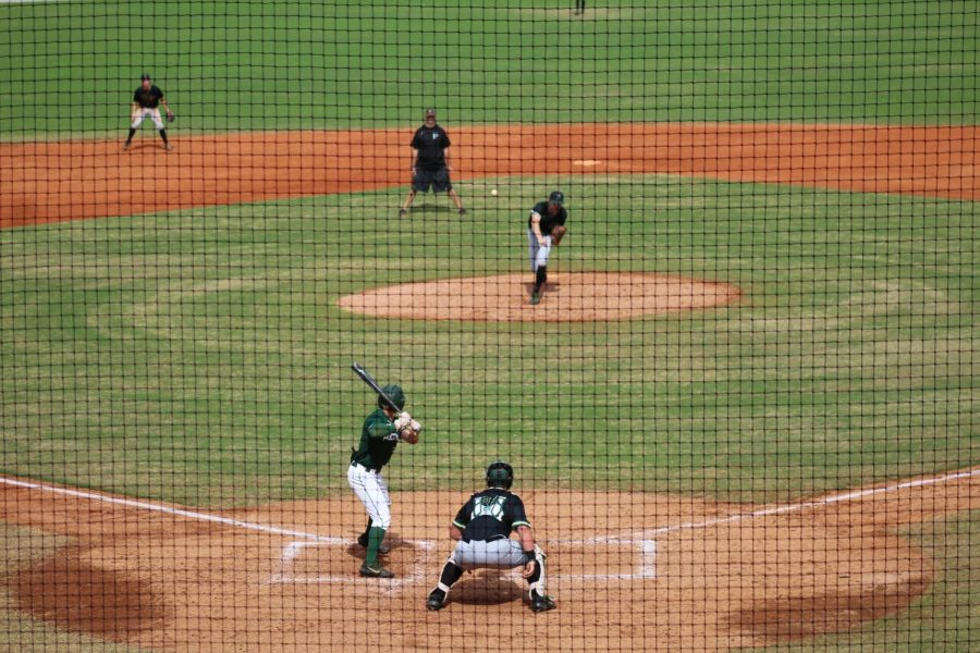 Sophomore Kelton Kieschnick throws a pitch to senior Zach Swindell. Zach Swindell is playing in his third Piedmont Fall World Series.  Picture Credit: Emma Marti