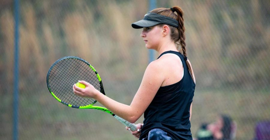 Senior Megan Waldheim is getting ready to serve.  She has helped lead the Lions to a perfect 7-0 conference record on the way to the number one seed in the USA South West Division Tournament.    Photo Credit: Karl L. Moore