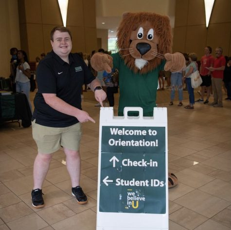 Sophomore biology major Maxwell Shaughnessy greets incoming freshmen with Leo the Lion at summer orientation. // PHOTO PIEDMONT UNIVERSITY INSTAGRAM