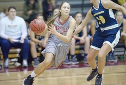 Klaire Varney dribbling down the court while being pressured by the opposing team, Emory & Henry. // PHOTO THE DAILY TIMES