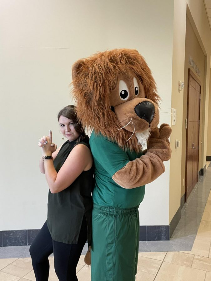 New Director of Residential Living, Madison Smith, poses with Leo the Lion during summer orientation. // PHOTO BY MELISSA SCUDERI
