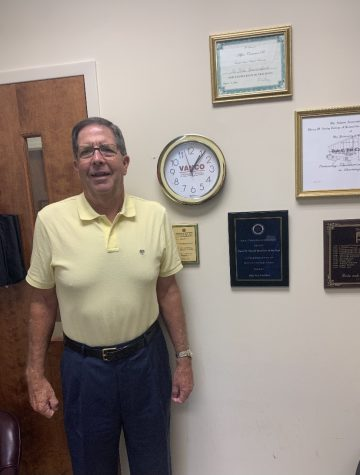 Dr. Dale Van Cantfort posing next to his Rotary award. // Photo Courtesy of Dr. Van Cantfort.